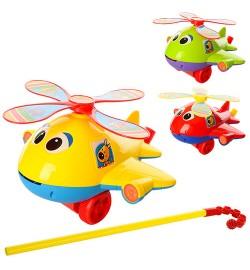 Каталка 0368 (72шт) на ціпку 41см, вертоліт, звук, вращ.вінт, висов.язик, 3 кольори, в кульку, 22-21-13см